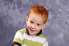 Cool dude. Redhaired boy smiling Stock Photos
