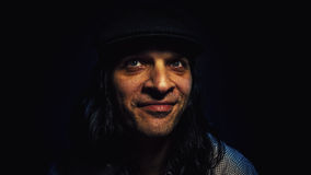 Cool Dude in Cool Mood. Cool dude in good mood, portrait of a man with hat, smiling and looking aside stock image