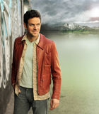 Cool dude outside. Outdoor portrait of a young man in cool clothing walking outdoors Stock Image