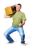 Cool dude with a speaker on the shoulder. White background, music attack concept Stock Photos