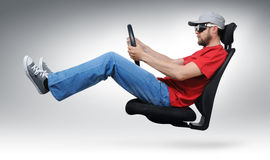 Cool dude with the wheel flies on an office chair. On background Royalty Free Stock Photo