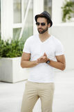 Cool dude in white with shades. And hat Stock Photography