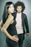 Cool elegant model couple posing in studio looking at camera Royalty Free Stock Image