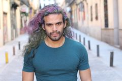 Cool ethnic man with multicoloured dyed hair.  royalty free stock photography