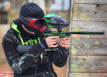 Cool extreme sportsman. Playing paintball Royalty Free Stock Photography