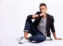 Cool fashion male model sitting Royalty Free Stock Photos