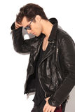 Cool fashion model in leather jacket looking down Royalty Free Stock Photo