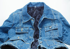 Cool fashionable blue jeans jacket lined with artificial dark blue fur Royalty Free Stock Photography