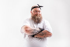 Cool fat man with beard posing royalty free stock photography