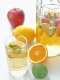 Cool fresh lemonade drink. Refreshing summer sangria. Homemade punch with fresh fruits and mint leaves. Vertical Royalty Free Stock Photography