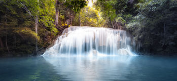Cool fresh water pond in forest with smooth and silky waterfall Royalty Free Stock Image