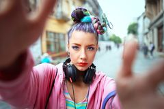 Free Cool Funky Young Girl With Headphones And Crazy Hair Enjoy Power Of Music Taking Selfie On Street Stock Photos - 153321733
