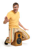 Cool funny dude dancing on the speaker. Cool funny dude dancing while sitting on the speaker white background, musical concept Royalty Free Stock Photo