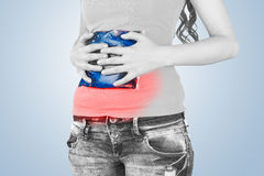 Cool gel pack on hurting stomach. Royalty Free Stock Photo