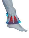 Cool gel pack on a swollen hurting ankle. Stock Photo