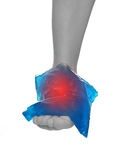Cool gel pack on a swollen hurting ankle. Stock Images