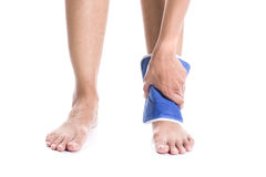 Cool gel pack on a swollen hurting ankle. Relief pain Royalty Free Stock Photos