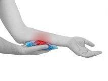 Cool gel pack on a swollen hurting arm. Royalty Free Stock Photo