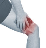 Cool gel pack on a swollen hurting calf. Stock Photos