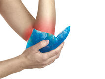 Cool gel pack on a swollen hurting elbow. Stock Photo