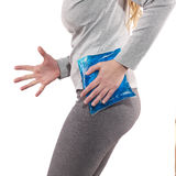 Cool gel pack on a swollen hurting hip. Royalty Free Stock Photo