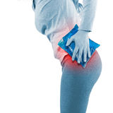 Cool gel pack on a swollen hurting hip. Stock Photo