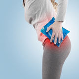 Cool gel pack on a swollen hurting hip. Royalty Free Stock Image