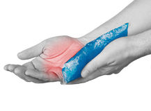 Cool gel pack on a swollen hurting palm Royalty Free Stock Images