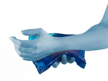 Cool gel pack on a swollen hurting wrist. Royalty Free Stock Photo