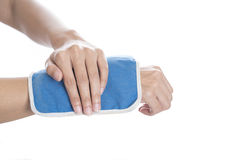 Cool gel pack on a swollen hurting wrist Stock Photo