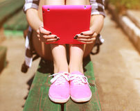 Cool girl with digital tablet pc resting. In the city park Stock Photos