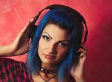 Cool girl DJ with dyed blue hair Stock Image