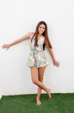 Cool girl with flowered short dress Royalty Free Stock Photos
