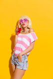 Cool girl and the fresh red drink Royalty Free Stock Images