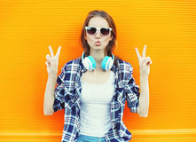 Cool girl having fun listens music over colorful Royalty Free Stock Photography