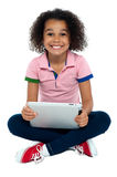 Cool girl kid sitting on the floor Stock Photo