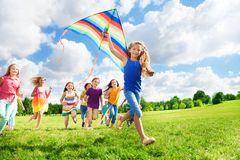 Cool girl with kite and her friends Royalty Free Stock Images