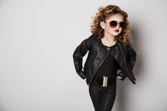 Cool girl in leather jacket with attitude Stock Image