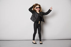 Cool girl in leather jacket posing Stock Image