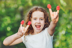 Cool girl making horn gesture. Royalty Free Stock Image