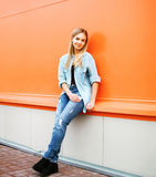 Cool girl posing against colorful wall, street fashion Royalty Free Stock Photo