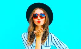 Cool girl with red lips is sends an air kiss in a sunglasses Royalty Free Stock Image