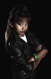 Cool girl rocker with a haircut - crest on black background Royalty Free Stock Photos