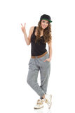 Cool girl showing victory hand sign Royalty Free Stock Photography