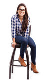 Cool girl sitting on a chair Stock Photography
