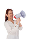 Cool girl speaking through a megaphone Royalty Free Stock Photos