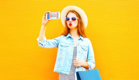 Cool girl takes a picture self portrait on smartphone Royalty Free Stock Images