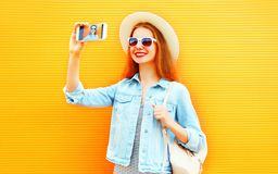 Cool girl woman takes a picture self portrait on a smartphone Royalty Free Stock Photos