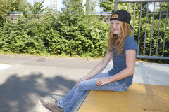 Cool girl. Cool young girl relaxing outdoor Royalty Free Stock Photo