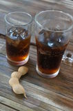 Cool glass of cola and tamarind in thailand Royalty Free Stock Images